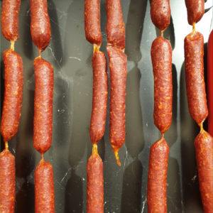 Saucisses sèches piquantes - Les Sentiers d Afrique Chez Chantal - Boucherie spécialisée viande fumée Bruxelles